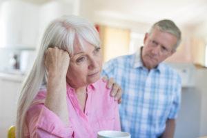 older man comforting a woman