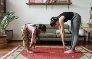 mother and daughter stretching exercise