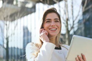 smiling successful person on phone with tablet