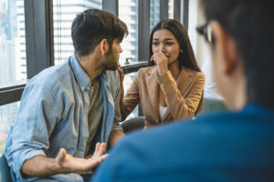 Psychotherapist inquiring about symptoms occurring within mind from couple patients with mental health problems. Group psychotherapy for support and helping worried man to change negative mindset