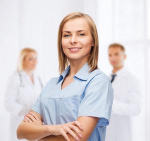 healthcare and medicine concept - smiling female doctor or nurse