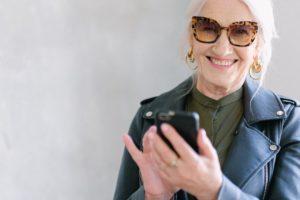 Happy senior woman on phone