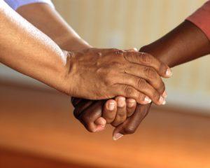 doctor clasped comfort hands people