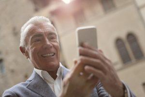 happy older man on phone